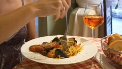 Venice restaurant women eating sea food dinnert pasta with cocktail 4k italy Stock Footage
