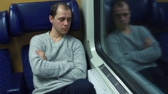 Tired man in sweater sleeping in his seat in a train. 4K video Stock Footage