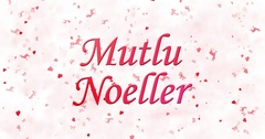 """Merry Christmas text in Turkish """"Mutlu Noeller"""" turns to dust from bottom on Stock Footage"""