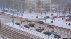 It's snowing in the city, the road, cars driving on snowy road Stock Footage