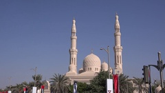 Dubai gorgeous Mosque with palm trees around and UAE national flag waving 4K Stock Footage