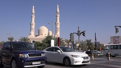 Luxury car in traffic Dubai cityscape yellow taxi cab driving in front of mosque Stock Footage