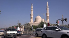 Crowded car traffic in emirates arabian cars driving islamic mosque back view 4K Stock Footage