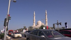 Dubai emirate cityscape car driving in front of great mosque crowded car traffic Stock Footage