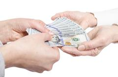 Hands giving money to other hands Stock Photos