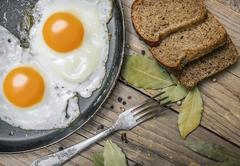 Fried egg on a cast iron pan Stock Photos