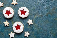 Cookie stars. Homemade ginger cookies with strawberry jam. Copy space. Flat lay Stock Photos