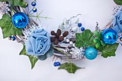Christmas decorative wreath with ivy leaves, fir-tree balls, cones and Stock Photos