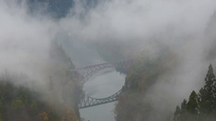 Beautiful views, steam locomotive rides over the bridge in the morning fog Stock Footage