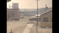 Vintage 16mm film, 1940 Illinois, coal mine going home after work, high angle Stock Footage