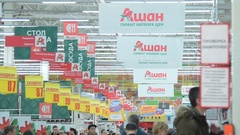 Banners, pointers and customers in Auchan hypermarket, Russia Stock Footage
