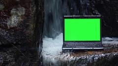 Laptop under waterfall Stock Footage