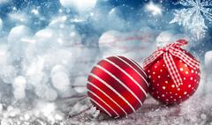 Red Christmas balls over sparkling holiday background Stock Photos