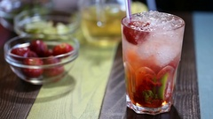 Fruit lemonade with tube on table Stock Footage