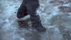 Boy running on thin ice, slow motion Stock Footage