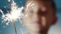 Adorable happy little blond boy makes a wish Stock Footage