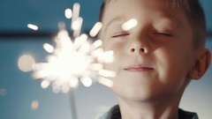 Happy adorable kid celebrating his birthday and make a wish Stock Footage