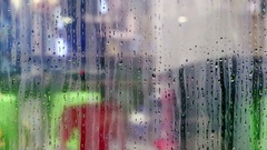 Water drops sliding down on store window glass Stock Footage