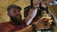 The bearded bartender pours a beer Stock Footage