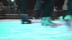 Concept Closeup Winter Sport. Crowd at Night City Skating Rink Pedestal and Blur Stock Footage