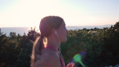 Closeup - Side view of sporty woman with a slender figure running at the seaside Stock Footage