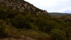 Mountin sky smog, Crimea, mountains and trees in autumn Stock Footage