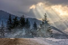 Stormy weather over forest in mountains Stock Photos