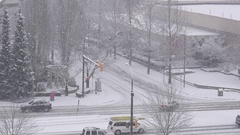 Pan shot of traffic flow on cold blizzard snow winter day Stock Footage