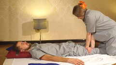 Woman making thai massage to a man Stock Footage