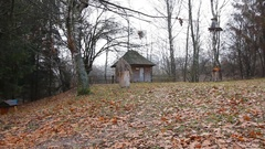 Old wooden barn and beehives in retro style, in the fall forest Stock Footage
