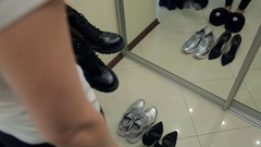 Footwear choice: combat boots, silver sneakers, high heel shoes Stock Footage