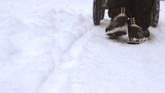 Winter walk through snowy field with baby carriage Stock Footage