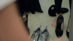 Reflection in mirror woman feet standing wearing shoes inside flat Stock Footage