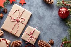 Christmas or New Year holiday present Xmas wrapped ribbon handmade gift box flat Stock Photos