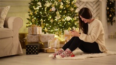 Beautiful Emotional Brunette Texting on her Gadget and Smiling Next to Large Stock Footage