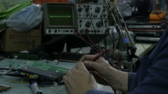 Repairman hands close measuring voltage on the PCB of broken TV set by Sheyno. Stock Footage