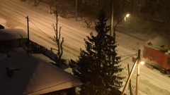 Snow removal machine cleaning tram rails at night Stock Footage