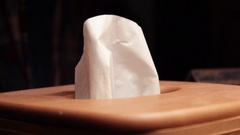 Hand picks up tissue kleenex in country living room ALT version Stock Footage