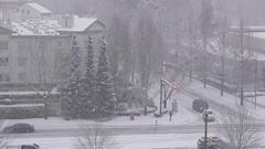 Pan shot of traffic flow on cold blizzard snow winter day with 4k resolution Stock Footage