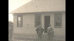 Vintage 16mm film, 1925 coal mine people and buildings Stock Footage