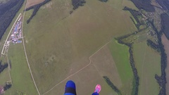 Professional skydiver fly on parachute in air above green field. Height. Sport Stock Footage
