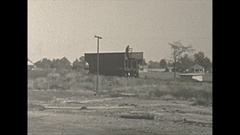 Vintage 16mm film, 1940 Illinois, coal mine, hopper car free wheeling and mine Stock Footage