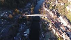 Rising aerial view of Iron Bridge, Shropshire, UK. Stock Footage