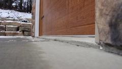 Wooden Garage door opening in snowy countryside Stock Footage