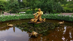 Orangery Fountain turned off, golden Triton sculpture with seamonster, orbiting Stock Footage