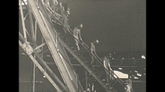 Vintage 16mm film, 1940 Illinois, coal mine end of shift, leaving the shaft... Stock Footage