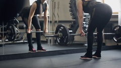 Athletic woman performs Romanian deadlift with a barbell in a gym Stock Footage