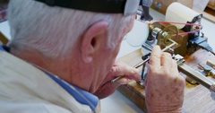 Horologist repairing a watch Stock Footage