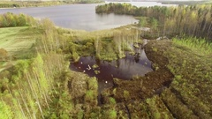 Aerial flyover shot of a constructed wetland for water treatment in Finland Stock Footage
