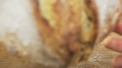Round Loaf of Bread Falling Down Stock Footage